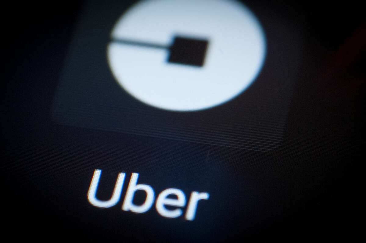 The Uber ride sharing app is seen on an Android portable device.
