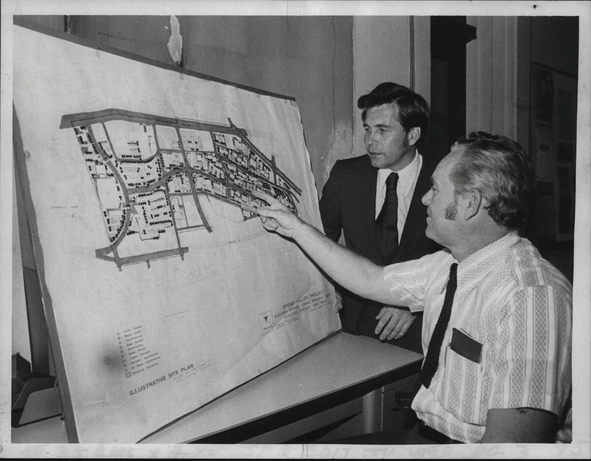 Richard Mullaney, attorney for Urban Renewal Association, and Donald Veitch, executive direcdtor of the Urban Renewal Agency, (seated) look over maps of the development of the Saratoga Springs City Center on Sept. 27, 1972 (Bud Hewig/Times Union Archive)