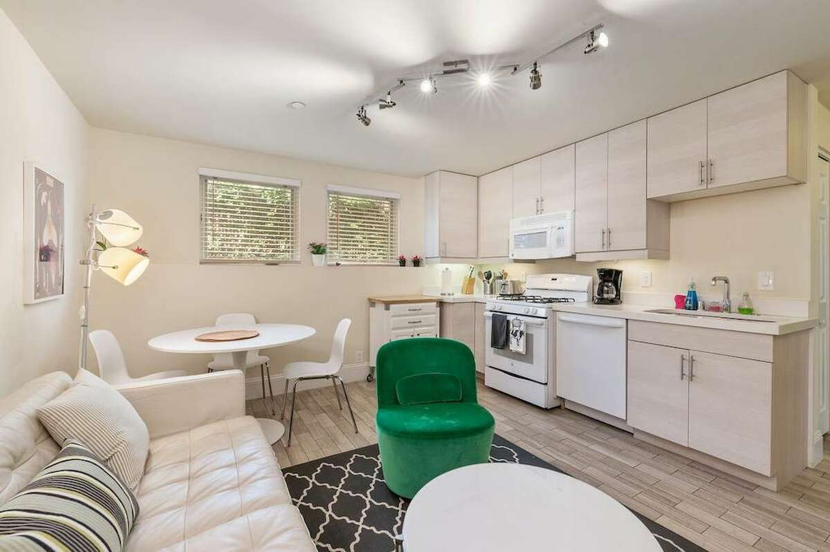 The interior has been updated and includes modern appliances in the kitchen.