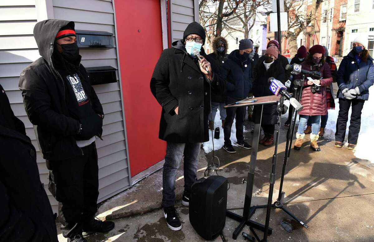 Ice the Beef Director Chaz Carmon, center, speaks at a vigil in honor of recent gun violence victims near the location of the shooting of Kevin Jiang on Lawrence Street in New Haven on Feb. 10, 2021.