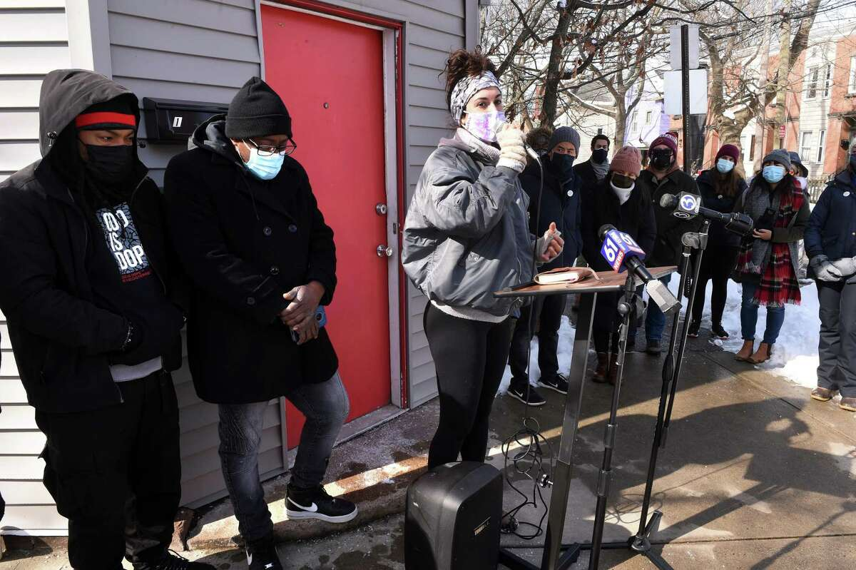 Ice the Beef member and neighborhood resident Natalia Katz, center, speaks at a vigil in honor of recent gun violence victims near the location of the shooting of Kevin Jiang on Lawrence Street in New Haven on Feb. 10, 2021.