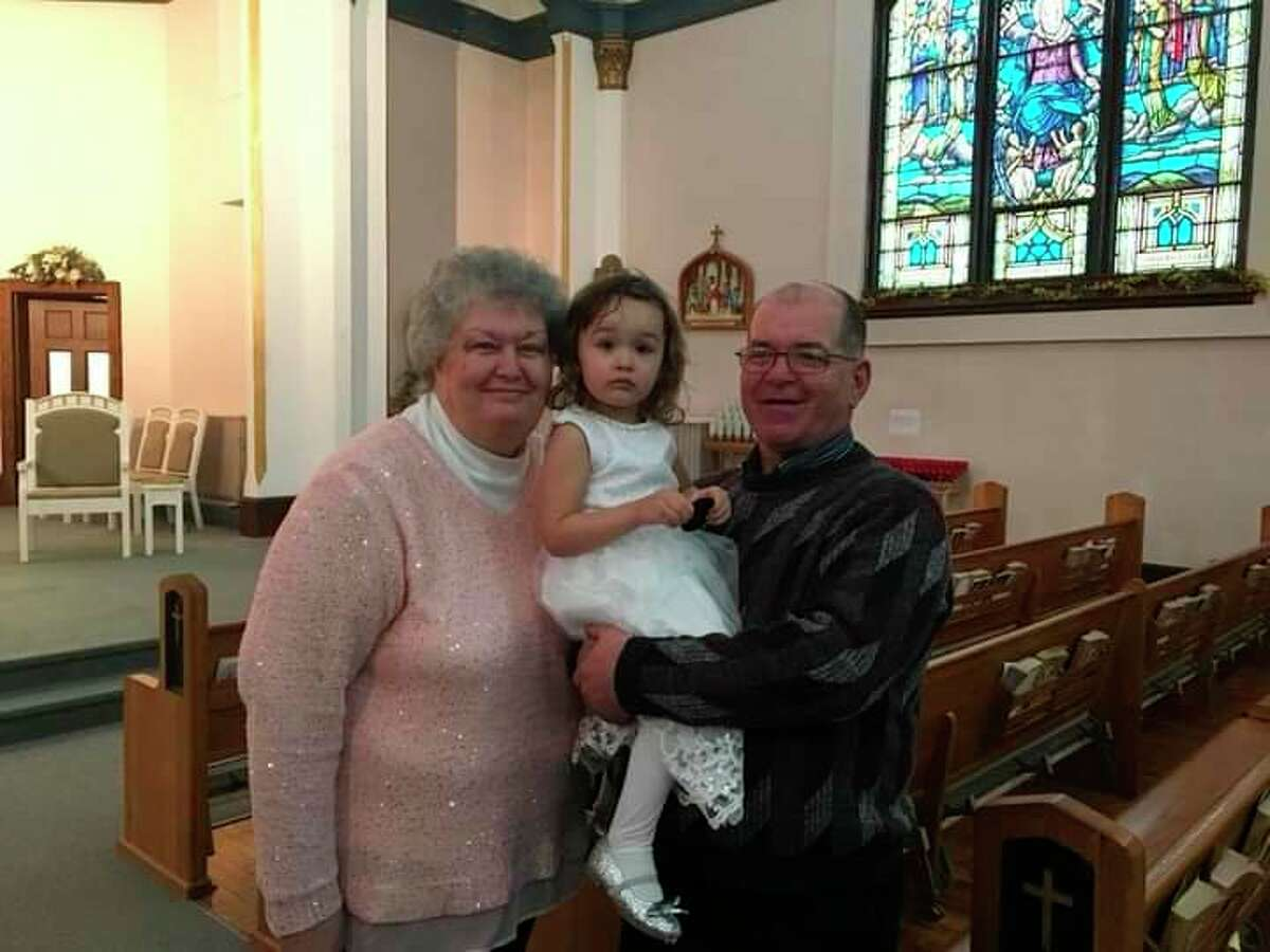 Charlotte and Donald Bredow Sr., pictured here with their granddaughter Ciara, have been married for 42 years. (Courtesy Photo)