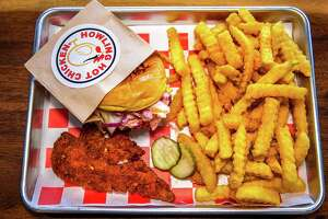 A combination meal from Howling Hot Chicken in Bridgeport, with tender, slider and fries.