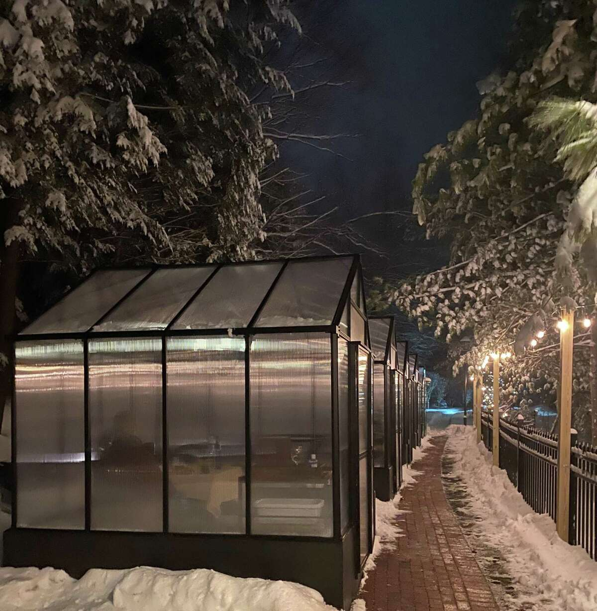 Greenhouses are set up outside Millwright's Restaurant in Simsbury.