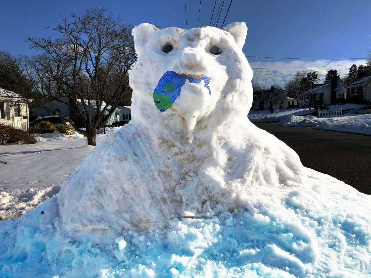 """The """"Mama Bear"""" snow sculpture, created over the past weekend by family and friends of Karen Terrio-Malave, guards their property on Fowler Avenue in Middletown."""