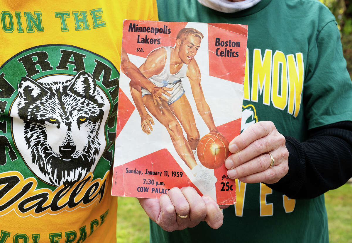Gary Johnson and Erik Kellner hold the program from the first NBA game in the Bay Area, which was between the Boston Celtics and Minneapolis Lakers in 1959. They were high schools when they saw the game at the Cow Palace.