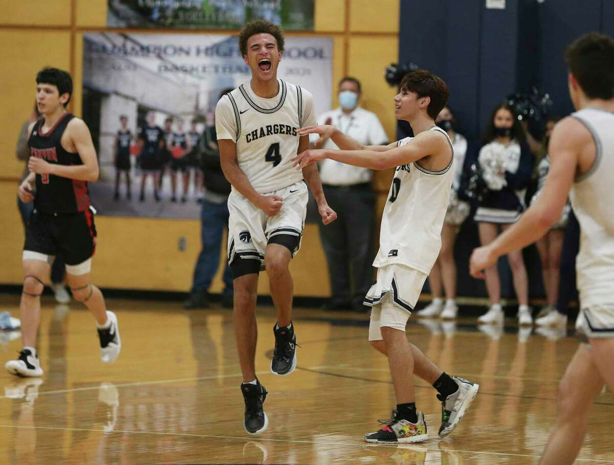 Boerne Champion's Jesse Peart (04) reacts after scoring a fast break dunk against New Braunfels Canyon in boys basketball in Boerne on Tuesday, Feb. 9, 2021. Boerne Champion defeated NB Canyon, 66-25.