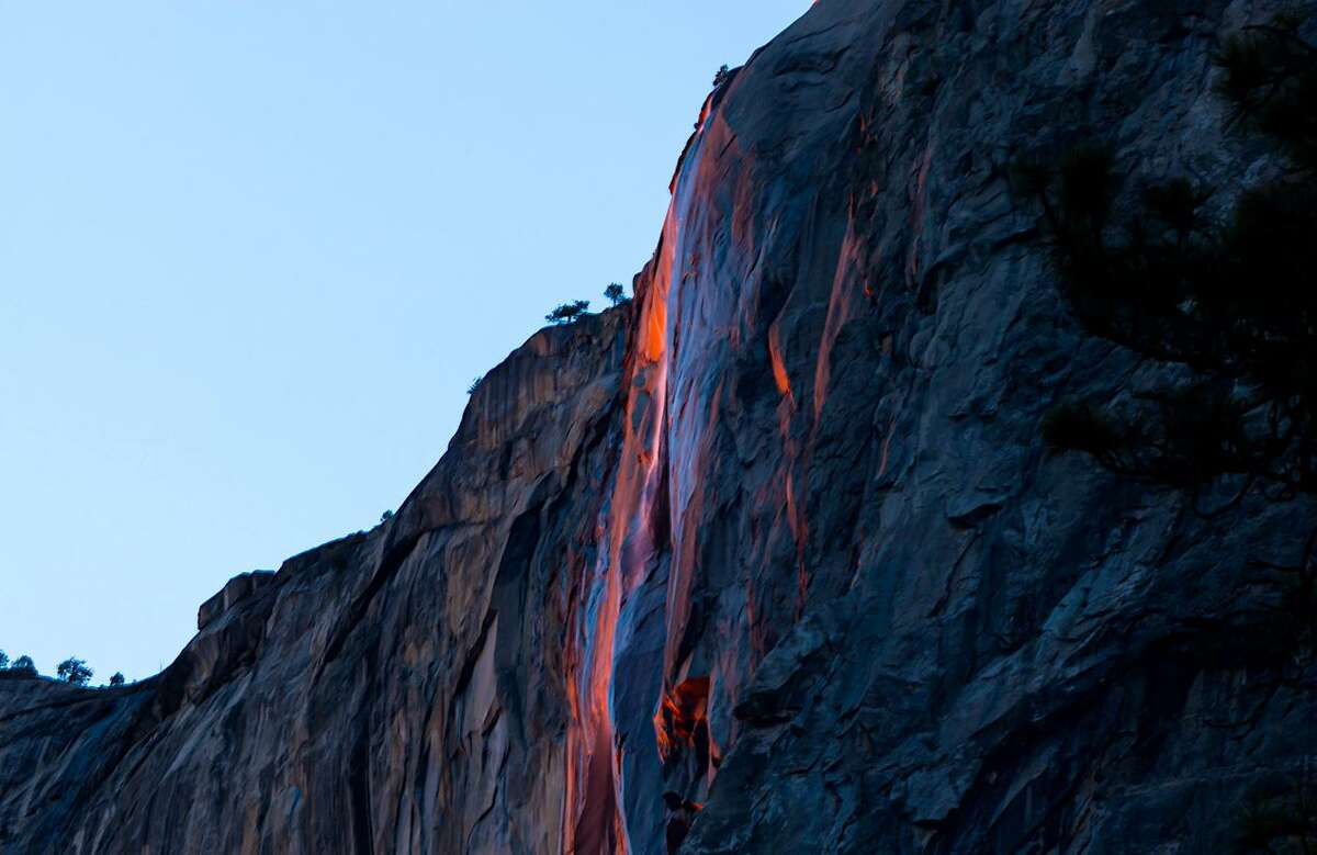 The firefall in Yosemite National Park occurs when sunlight entering the valley at dusk dips to just the right angle, refracting through the 1,575-foot Horsetail Fall.