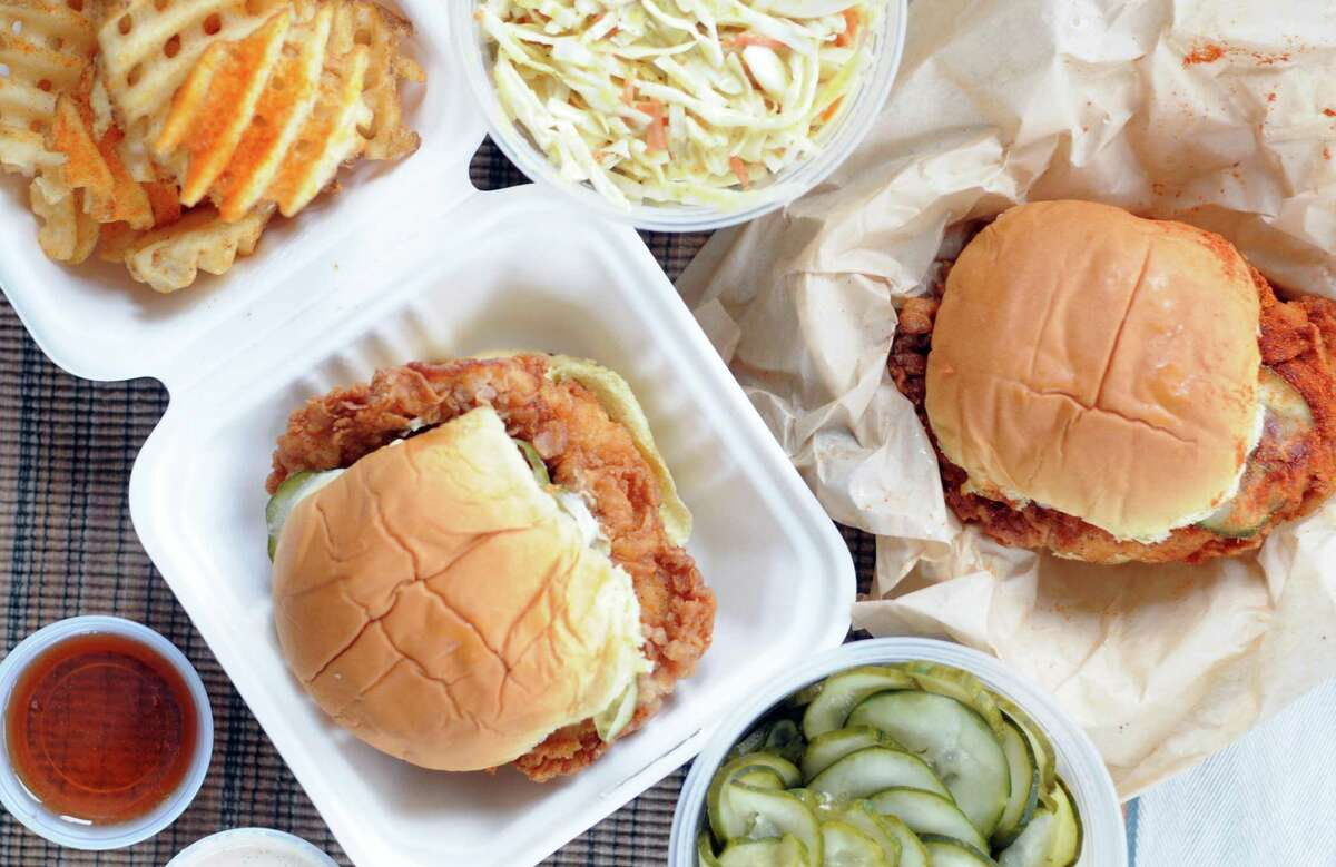 Waffle fries, coleslaw and sandwiches from Motel Fried Chicken