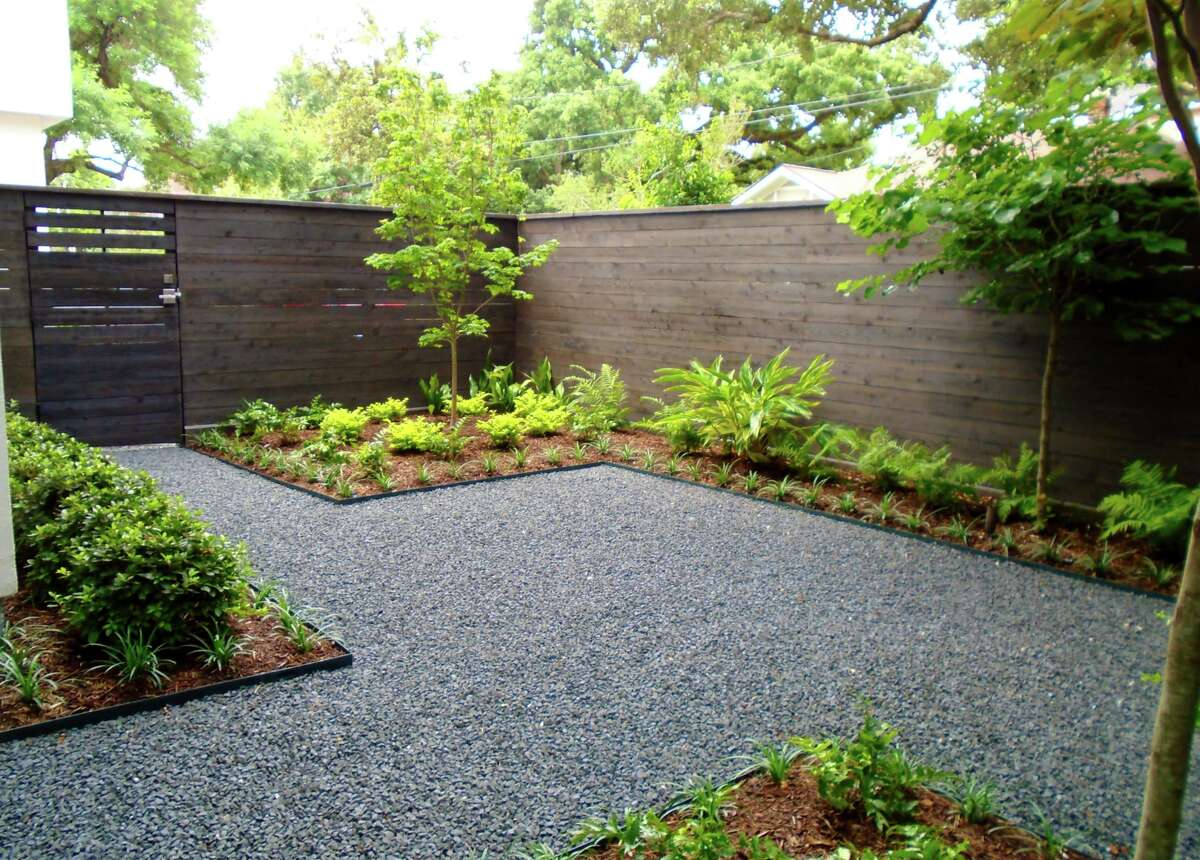 A modern mix of hardscaping and landscaping provides a low-maintenance backyard patio that befits both smaller budgets and gardening-challenged homeowners. This design by David Morello Garden Enterprises, Inc. is a fine example of a landscape architect-created setting that offers great ROI: Once the installation is complete, all you have to do is mind the green edges for years to come.