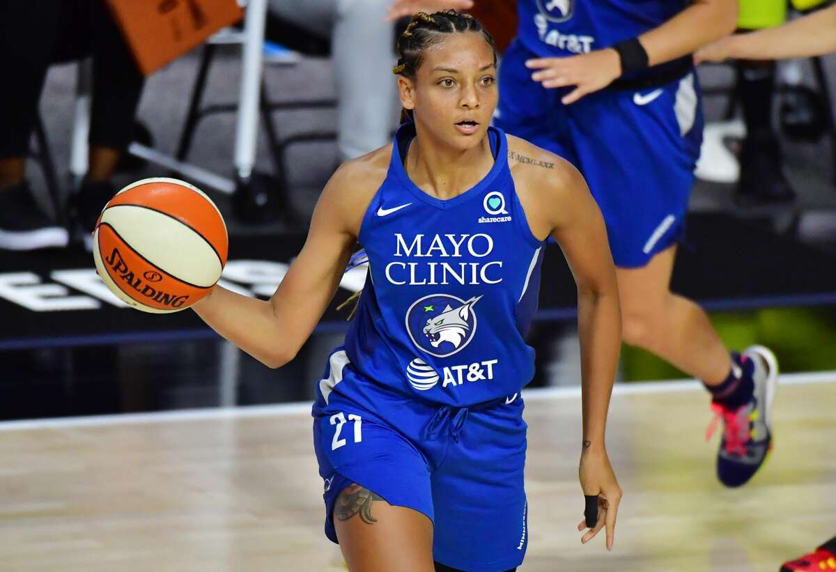 PALMETTO, FLORIDA - SEPTEMBER 06: Mikiah Herbert Harrigan #21 of the Minnesota Lynx looks to pass the ball during the first half against the Seattle Storm at Feld Entertainment Center on September 06, 2020 in Palmetto, Florida. NOTE TO USER: User expressly acknowledges and agrees that, by downloading and or using this photograph, User is consenting to the terms and conditions of the Getty Images License Agreement. (Photo by Julio Aguilar/Getty Images)