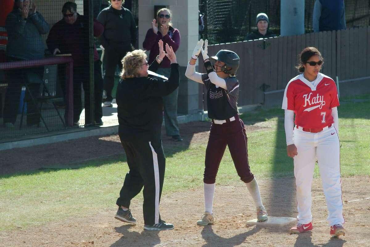 Pearland softball coach Laneigh Clark congratulates Gabrielle Davila last year against Katy. Davila returns to Pearland's outfield this year.