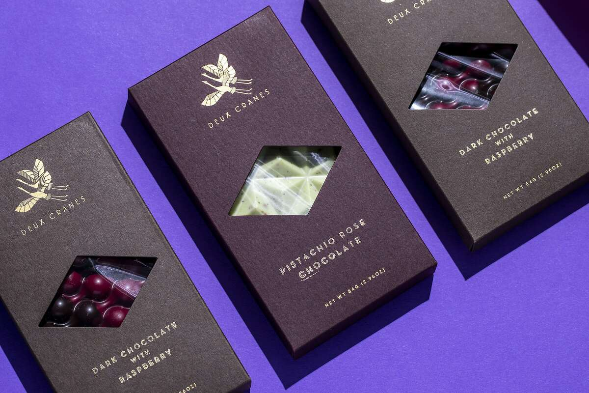 Pistachio rose chocolate and dark chocolate with raspberry by Deux Cranes photographed in San Francisco, Calif. on Monday, Feb. 8, 2021.