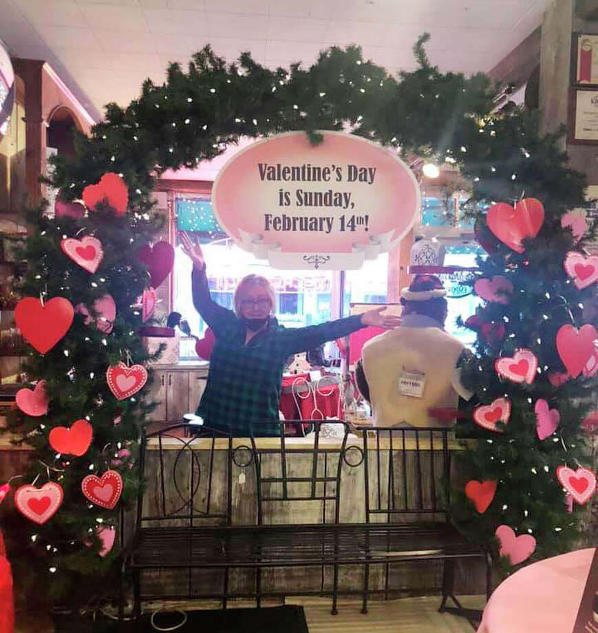 A Valentine's Day arch set up at the Old Pioneer Store and Emporium offers customers the opportunity to take a photo together. The store also will be offering a variety of Valentine's Day desserts for customers to purchase. Photo: Courtesy Photo