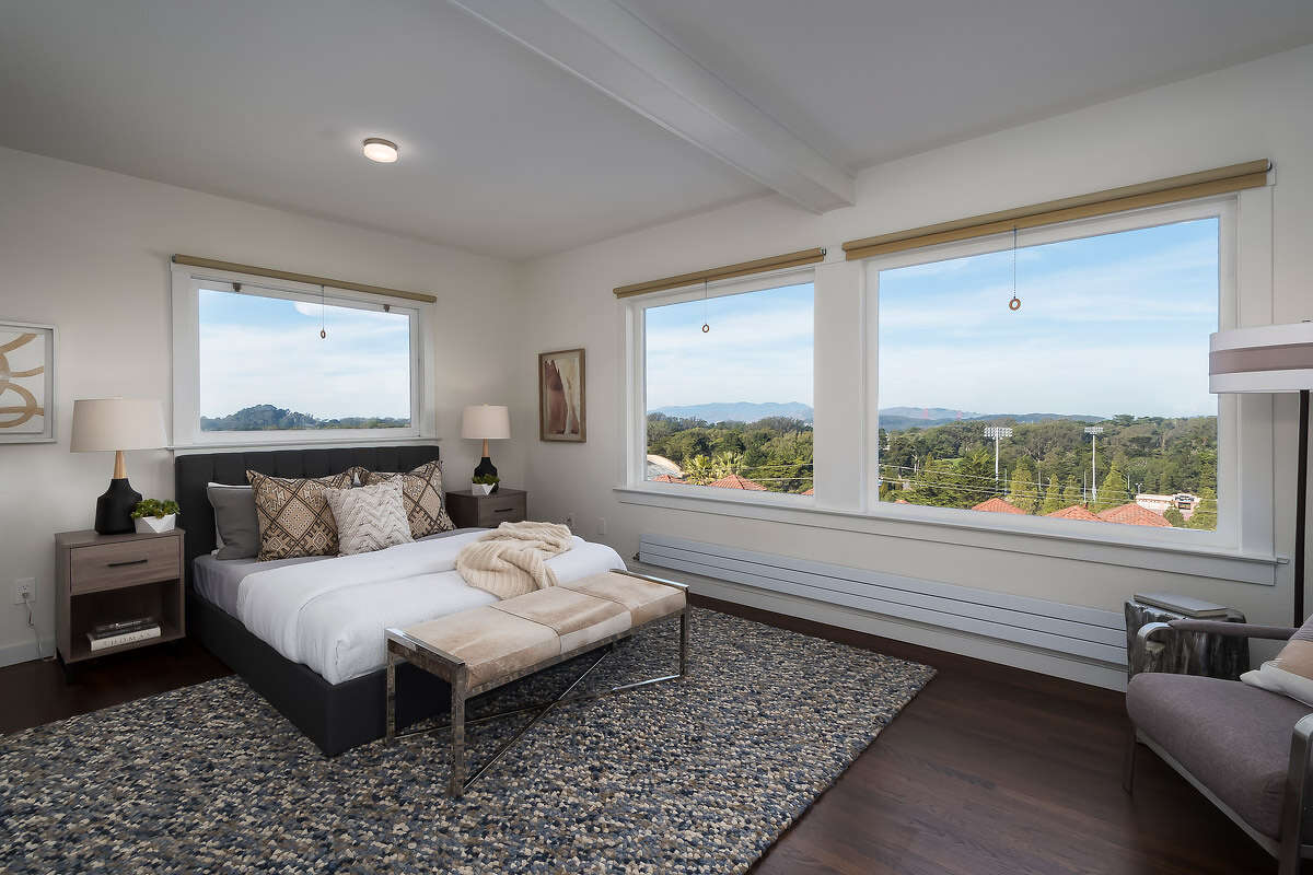 The home features four bedrooms. There are three on the top level with views, as well as a bed and bath on the lowest level (with its own private entrance).