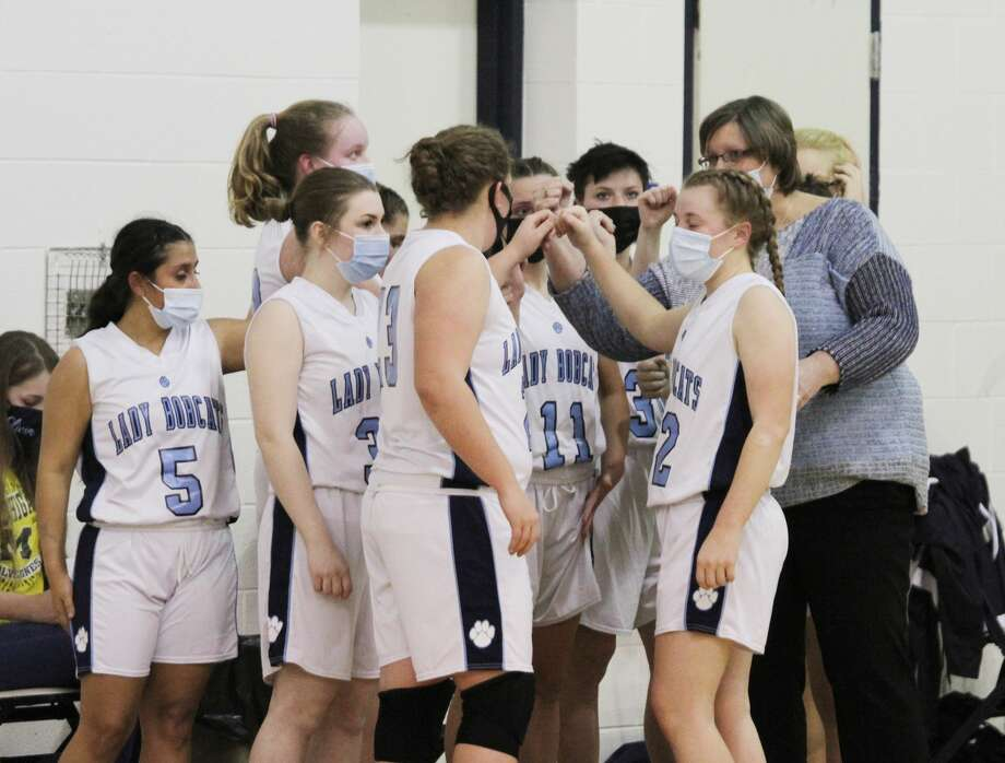 The Brethren girls varsity basketball team breaks from the huddle during their season opener on Tuesday night. The game was canceled before halftime due to an MHSAA official collapsing on the court. He was resuscitated through quick emergency response from Brethren staff and spectators. Photo: Dylan Savela/News Advocate