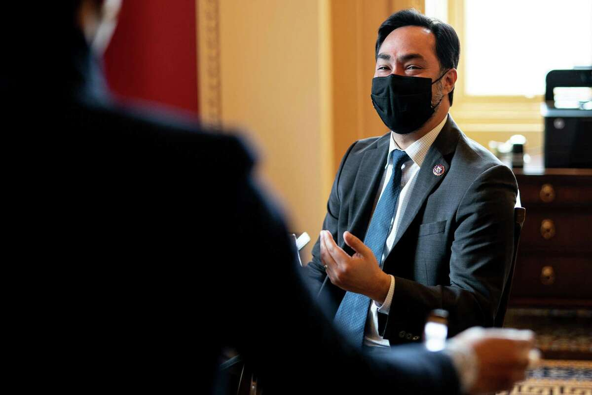 House impeachment manager Rep. Joaquin Castro (D-Texas) speaks with an aide on the second day of the second Senate impeachment trial for former President Donald Trump at the Capitol in Washington on Wednesday, Feb. 10, 2021. (Erin Schaff/The New York Times)