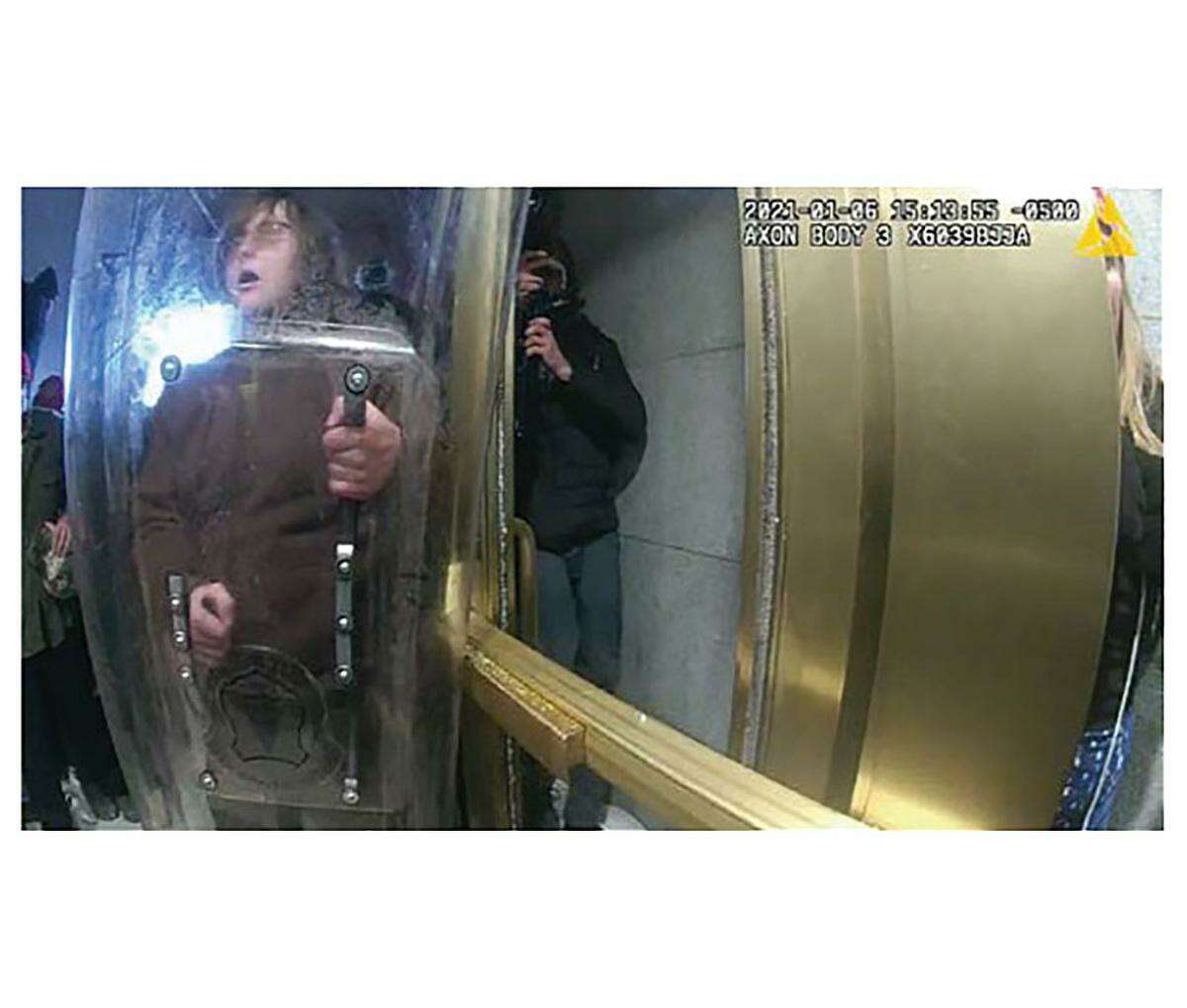 Patrick McCaughey, of Ridgefield, is seen holding a police shield, according to police, at the U.S. Capitol Jan. 6, 2021. McCaughey is still in police custody, but people who know him have written in support of his release.