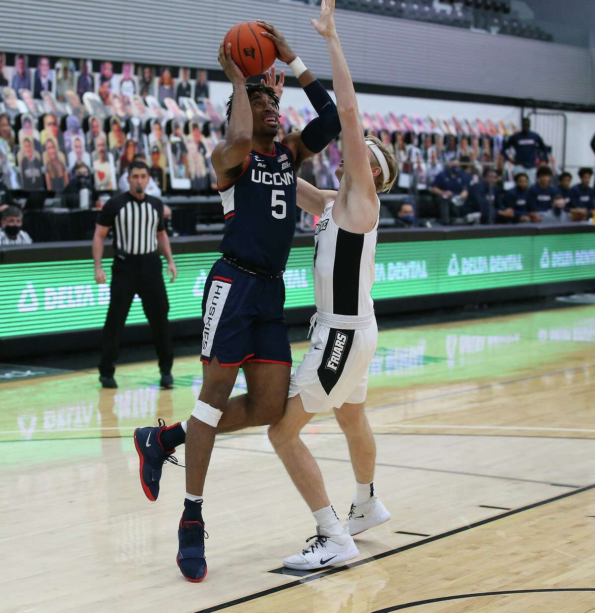UConn's Isaiah Whaley (5) goes up for a shot while defended by Providence's Noah Horchler (14) on Wednesday. UConn at Providence in an NCAA basketball game, Wednesday, Feb. 10, 2021, in Providence, RI. (Photo/Stew Milne)