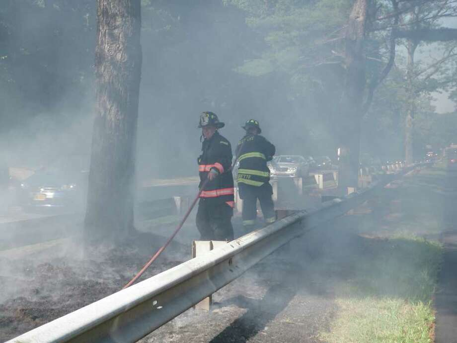 The Westport Fire Department responded to a brush fire in the medium on the Merritt Parkway Eastbound in Westport on Monday, Sept. 6, 2010. Photo: Contributed Photo / Westport News