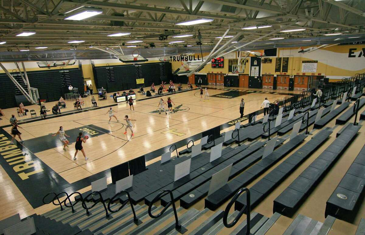 Ridgefied plays against Trumbull in girls basketball action in Trumbull, Conn., on Wednesday Feb.10, 2021. Strict COVID-19 measures prevented anyone to attend the game.