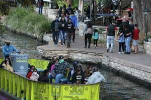 Some visitors to downtown San Antonio and the River Walk are seen not wearing masks on Friday, Jan. 8, 2021.