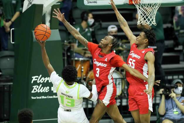 South Florida's Justin Brown (13) has his shot defended by Houston's DeJon Jarreau (3) and Brison Gresham during the first half of an NCAA college basketball game Wednesday, Feb. 10, 2021, in Tampa, Fla. (AP Photo/Mike Carlson) Photo: Mike Carlson, Associated Press / Copyright 2021 The Associated Press. All rights reserved
