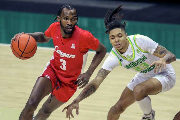Houston's DeJon Jarreau, left, drives past South Florida's Caleb Murphy during the first half of an NCAA college basketball game Wednesday, Feb. 10, 2021, in Tampa, Fla. (AP Photo/Mike Carlson) Photo: Mike Carlson, Associated Press / Copyright 2021 The Associated Press. All rights reserved