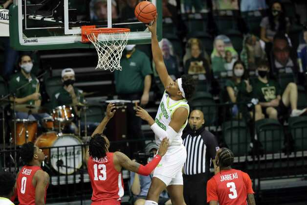 South Florida's Michael Durr shoots past Houston defenders Marcus Sasser (0), J'Wan Roberts (13) and DeJon Jarreau (3) during the first half of an NCAA college basketball game Wednesday, Feb. 10, 2021, in Tampa, Fla. (AP Photo/Mike Carlson) Photo: Mike Carlson, Associated Press / Copyright 2021 The Associated Press. All rights reserved