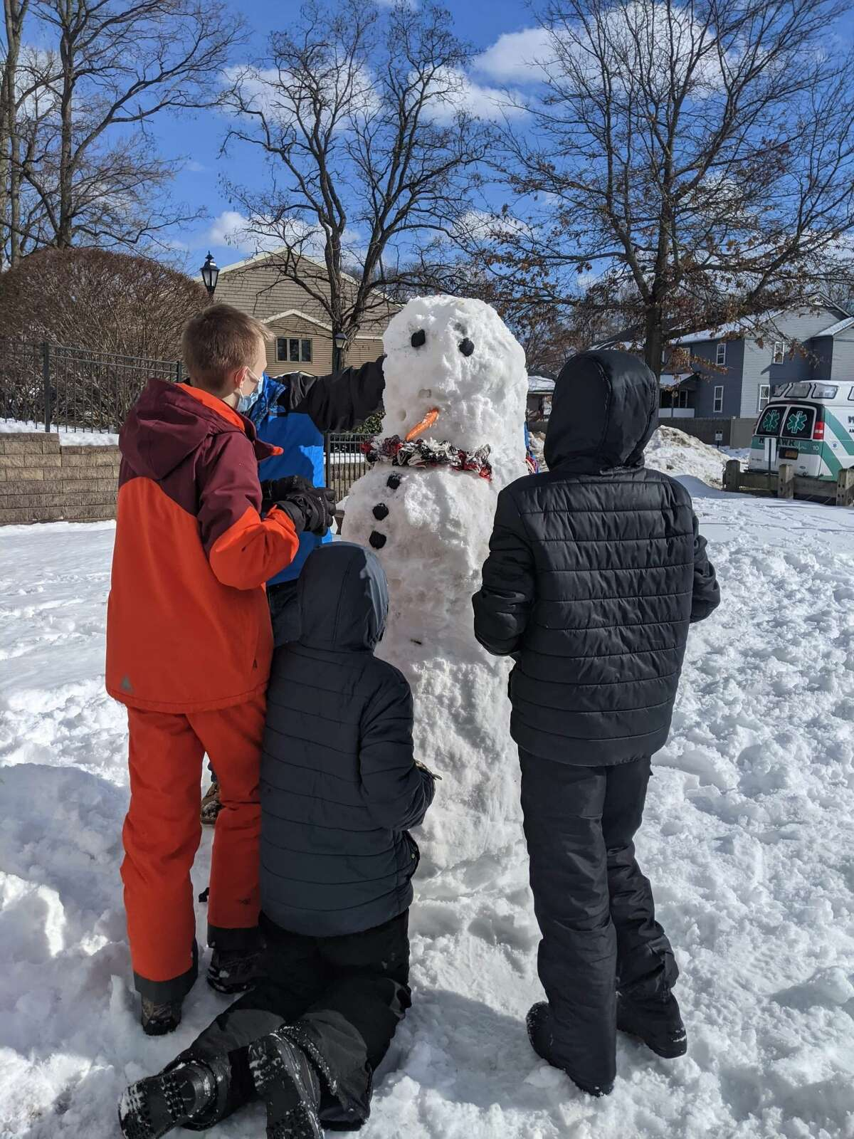 SCHENECTADY -- Local Troop 3357B gathered together to bring smiles to seniors' faces by making snowmen outside Kingsway Assisted Living Community's windows for them to enjoy. They also built them along the walkway for essential employees at Kingsway and Mohawk Ambulance as they came in to report for work. With pandemic limitations on young people's and senior's activities, and because essential workers have to gear up in PPE this was a great way to embrace the situation and bringing smiles to seniors faces, essential workers but also the kids, organizer Lindsay Phillips said.