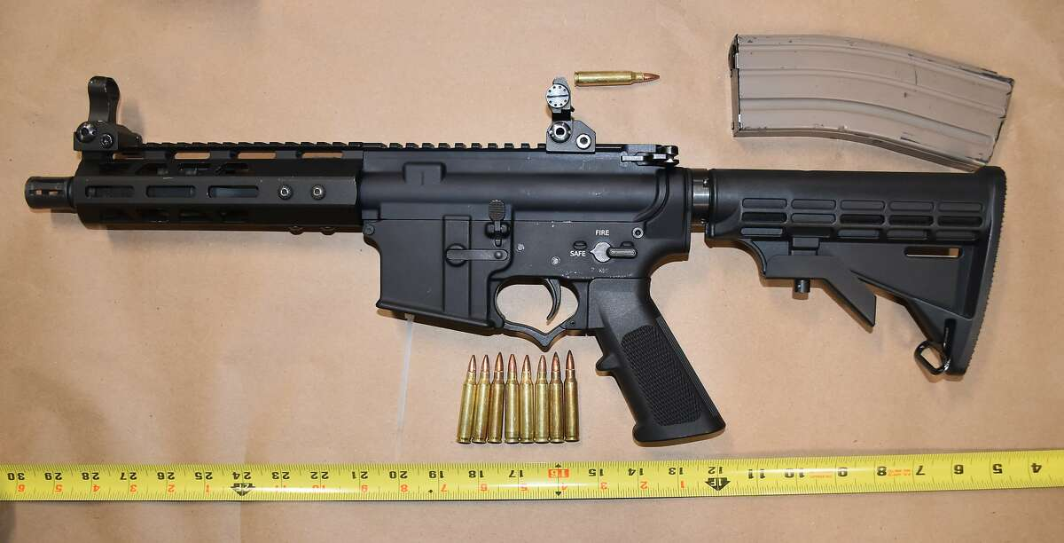 """Berkeley Police Department officials said they found this loaded AR-15-style rifle concealed in the clothing of a 15-year-old Richmond boy Tuesday night after a reported attempted carjacking. The 15-year-old was arrested on suspicion of attempted carjacking and """"several weapons related violations,"""" police said."""