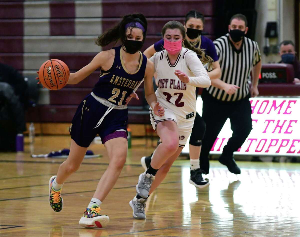 Amsterdam's Toni May is defended by Fort Plain's Ryleigh Hart during a basketball game on Wednesday, Feb. 10, 2021 in Fort Plain, N.Y. (Lori Van Buren/Times Union)
