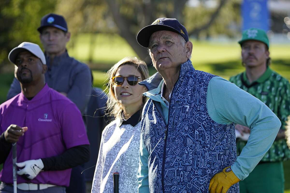From left, Alfonso Ribeiro, Steve Young, Kira K. Dixon, Bill Murray and Macklemore watch as Kathryn Newton hits from the third tee during the charity challenge event of the AT&T Pebble Beach Pro-Am golf tournament Wednesday, Feb. 10, 2021, in Pebble Beach, Calif. (AP Photo/Eric Risberg)
