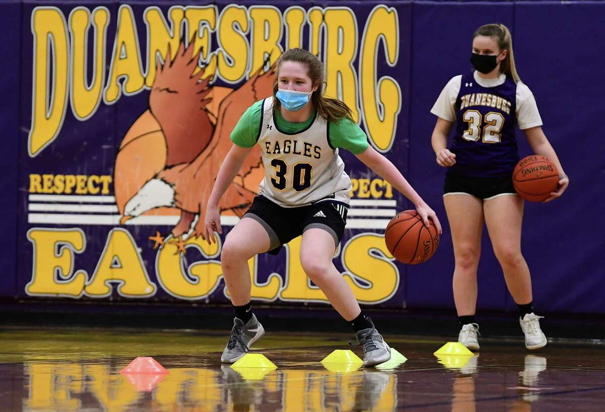 Duanesburg girls' basketball player Allison O'Hanlon dribbles during practice on Tuesday, Feb. 9, 2021 in Delanson, N.Y. Taylor Meyer waits for her turn at right. (Lori Van Buren/Times Union)
