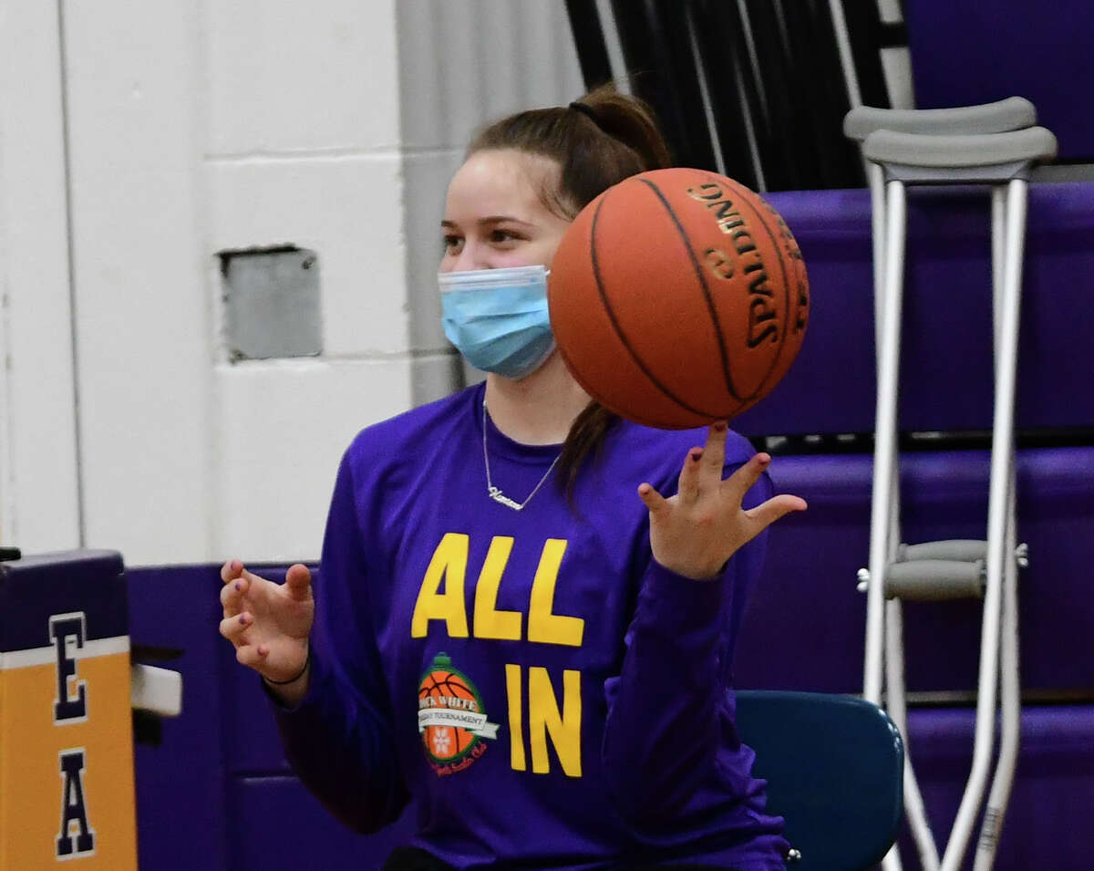 Injured player Madison Meyer is seen on the sidelines twirling a ball on her finger during Duanesburg girls' basketball practice on Tuesday, Feb. 9, 2021 in Delanson, N.Y. (Lori Van Buren/Times Union)