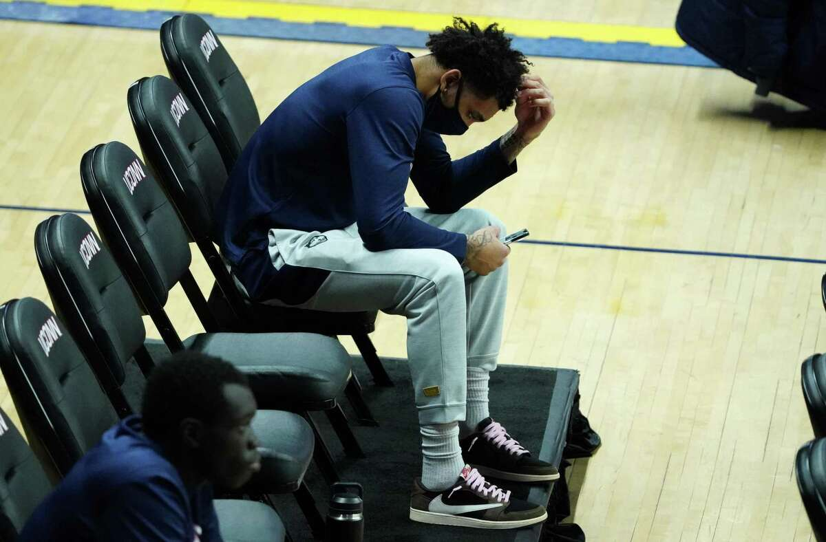 UConn guard James Bouknight sits on the sideline as his teammates warm up before a game against Butler in Storrs on Jan. 26.