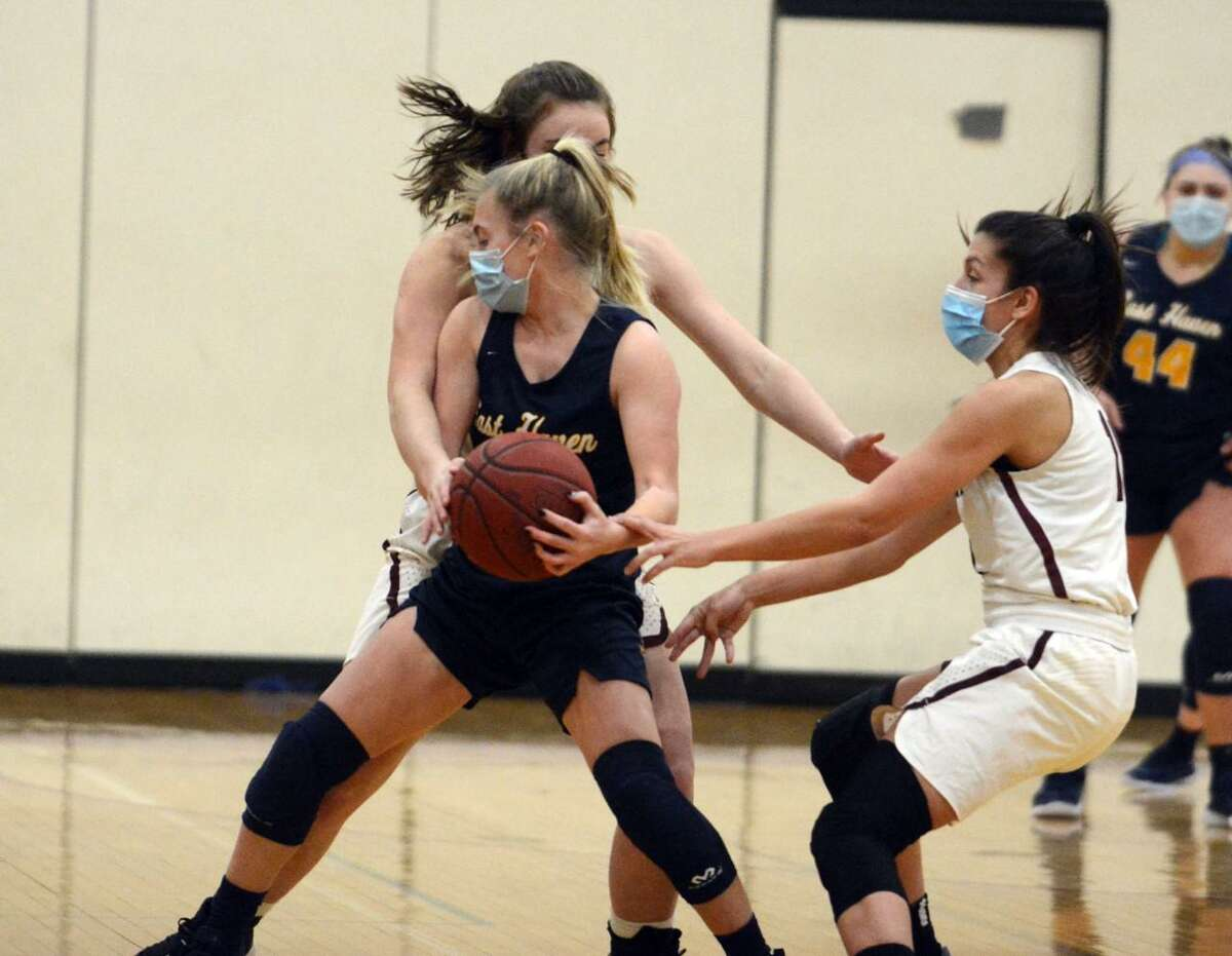 East Haven's Kate Pycela is guarded by a pair of North Haven defenders during Wednesday's contest.
