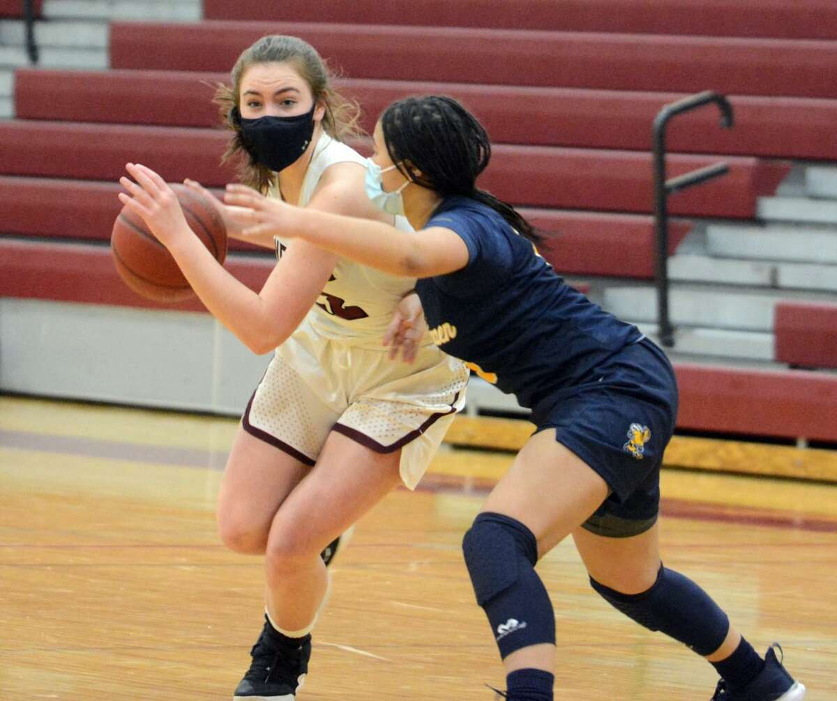 North Haven's Julia Bell drives past East Haven's Arielle Dupree during Wednesday's contest.