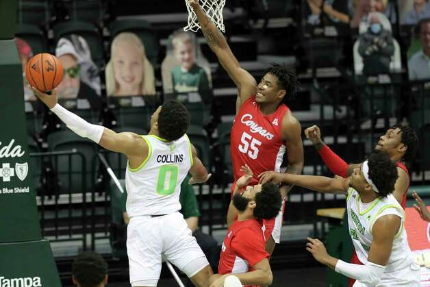 South Florida's David Collins (0) shoots past Houston's Brison Gresham (55) during the second half of an NCAA college basketball game Wednesday, Feb. 10, 2021, in Tampa, Fla. Houston won 82-65. (AP Photo/Mike Carlson) Photo: Mike Carlson, Associated Press / Copyright 2021 The Associated Press. All rights reserved
