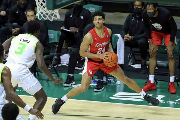 Houston's Quentin Grimes steps out to shoot against South Florida's Prince Oduro during the second half of an NCAA college basketball game Wednesday, Feb. 10, 2021, in Tampa, Fla. Houston won 82-65. (AP Photo/Mike Carlson) Photo: Mike Carlson, Associated Press / Copyright 2021 The Associated Press. All rights reserved