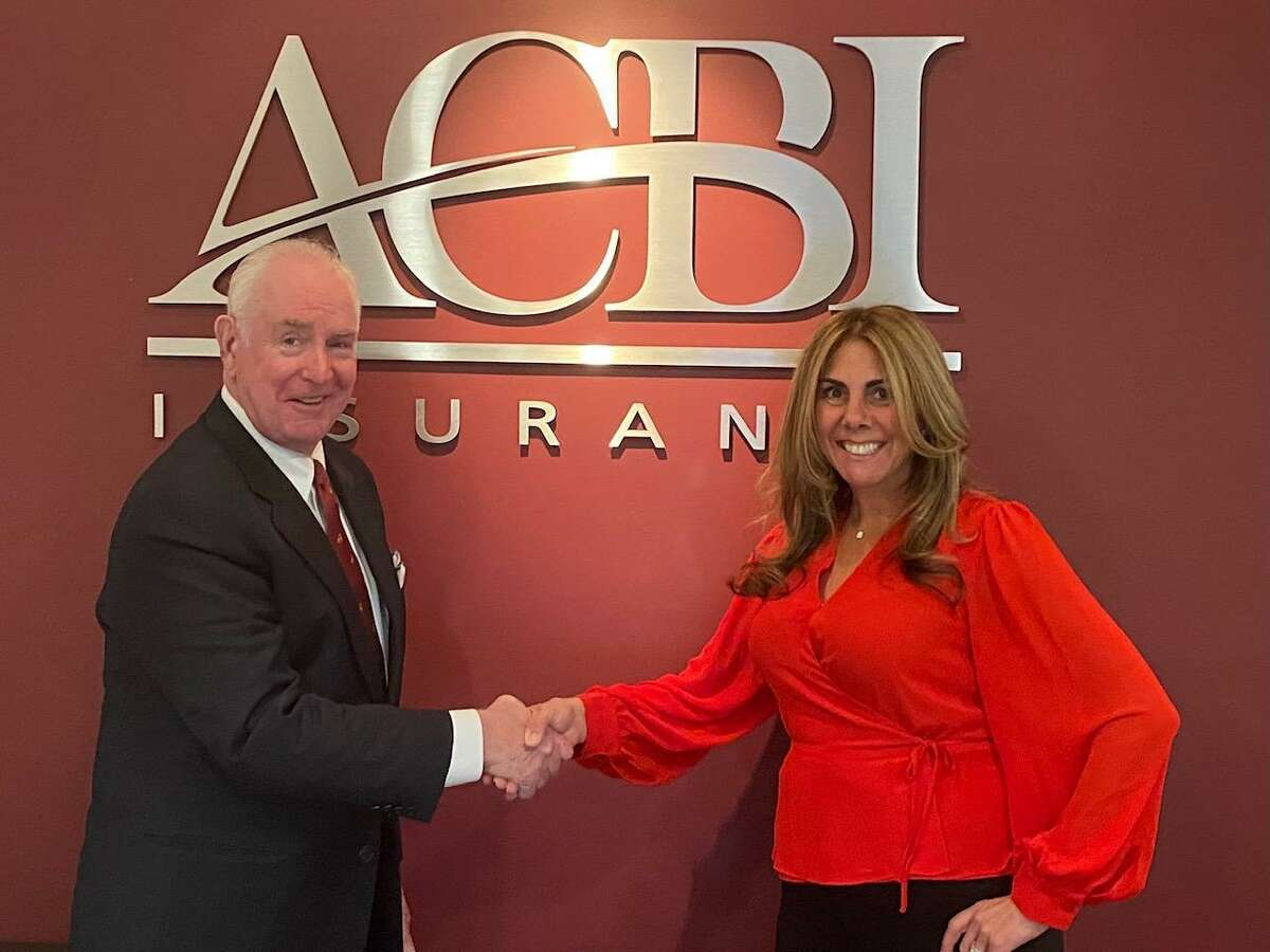 Daniel F. Keane, president of ACBI Insurance in Shelton, left, welcomes Kim DiMatteo, right, as the new senior vice president at ACBI Insurance. DiMatteo Insurance in Shelton merged in early 2021 with ACBI Insurance to become one of the largest insurance firms in Connecticut with their combined 3,000 clients and 40 employees.