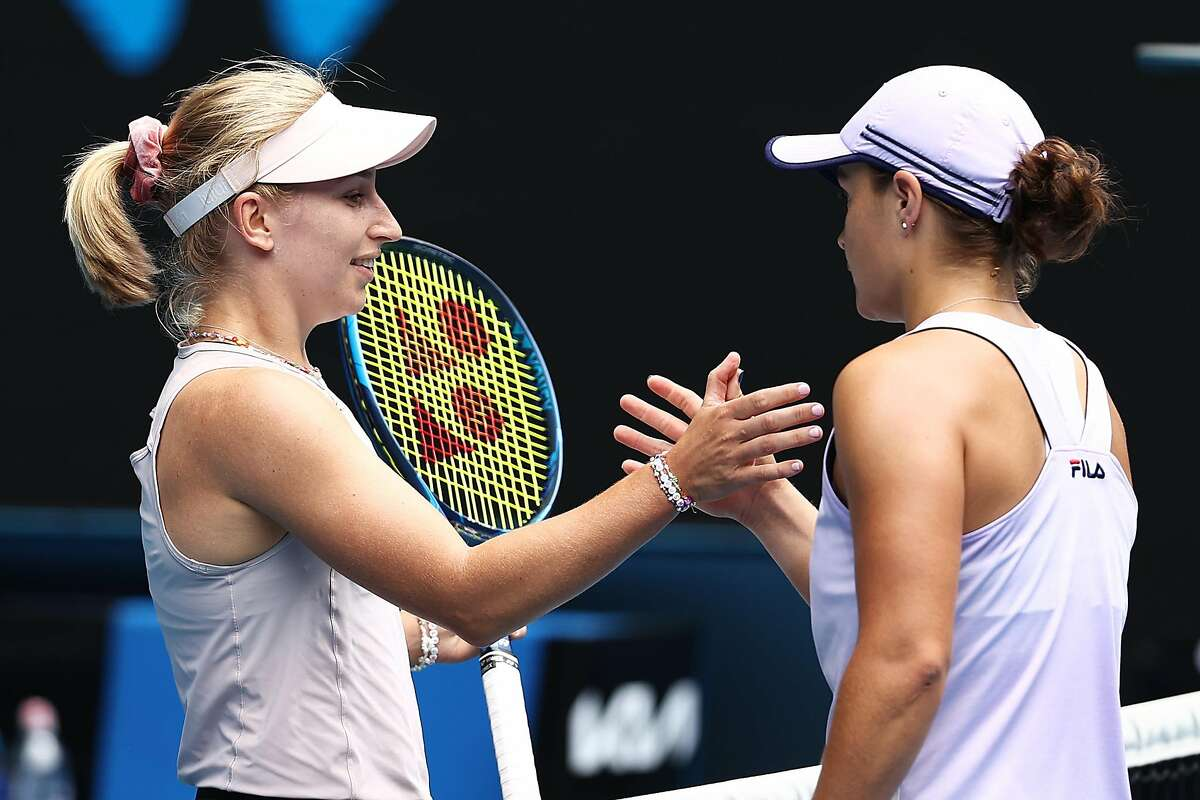 MELBOURNE, AUSTRALIA - FEBRUARY 11: Daria Gavrilova of Australia and Ashleigh Barty of Australia embrace at the net following their Women's Singles second round match during day four of the 2021 Australian Open at Melbourne Park on February 11, 2021 in Melbourne, Australia. (Photo by Mark Metcalfe/Getty Images)
