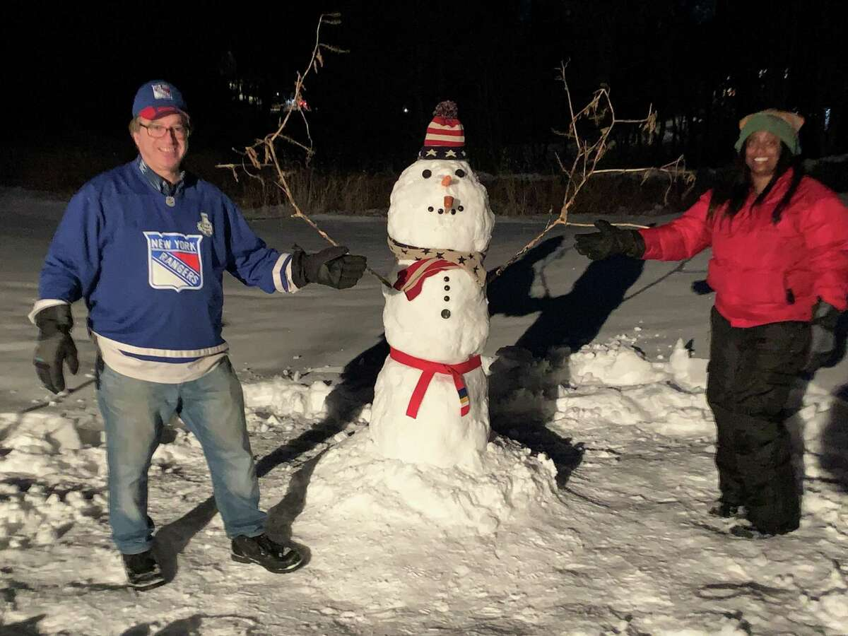 Joshua Nessen and Selina Cohen with Frosty February Nessen the Fourth, at their home in Weston on Feb. 4.