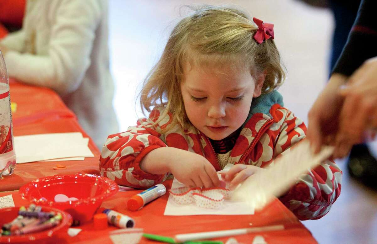 Francie Kirt, previously creates a Valentine's Day card during the Pequot Library's Kids' Candymaking Workshop in Southport, Conn., during a previous year. Kindergarten registration for the Westport Public Schools in Westport, Connecticut, is underway for the 2021-2022 school year.