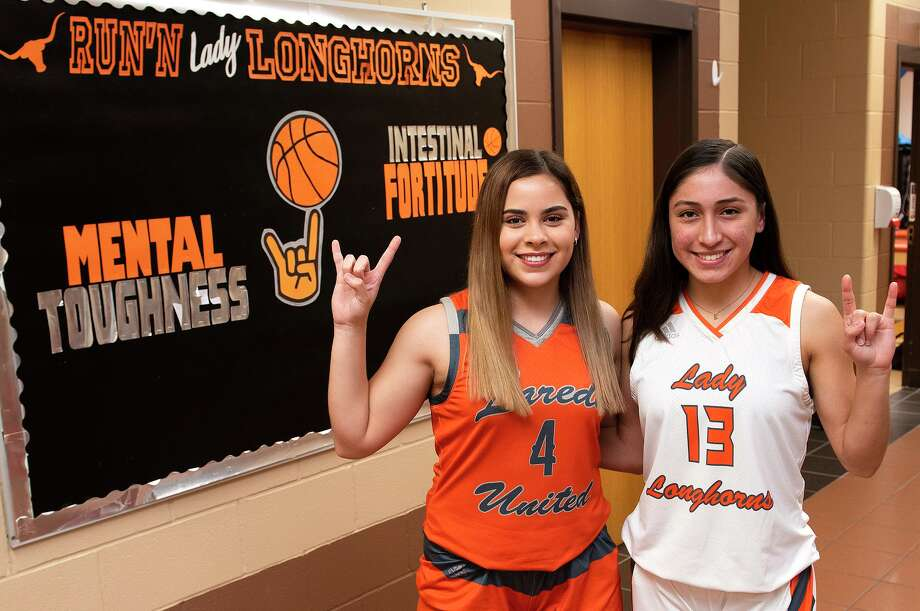 Evelyn Quiroz and Elisa Peralta are United's first girls' basketball players in the modern era to be part of three straight district championship teams. Photo: Danny Zaragoza / Laredo Morning Times