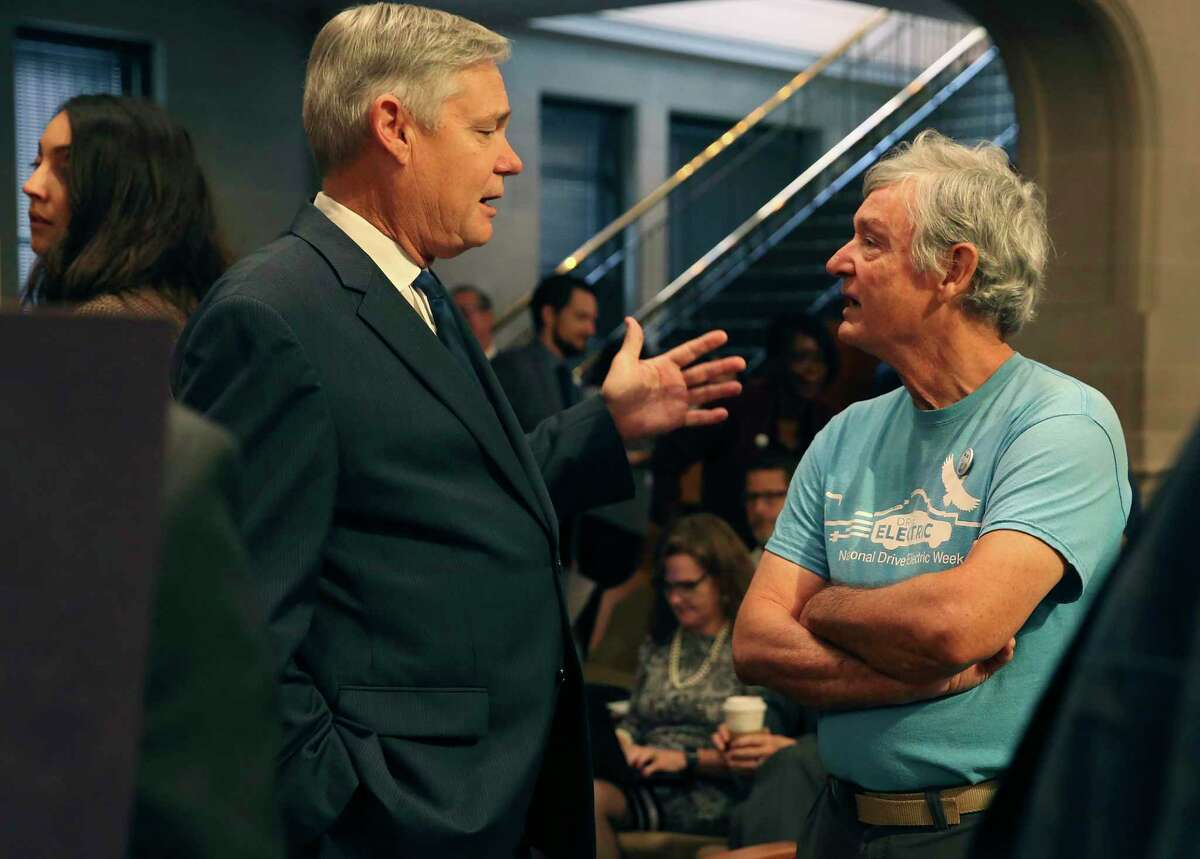 District 10 Councilman Clayton Perry, left, talks with Alan Montemayor, right, a supporter of the Climate Action and Adaption Plan, in pre-coronavirus days, before the start of the council's regular meeting, Oct. 17, 2019. The council voted 10-1 that day to pass the plan with Perry the lone vote against it. Thursday, the council is set to vote on hiring a firm to promote the plan.
