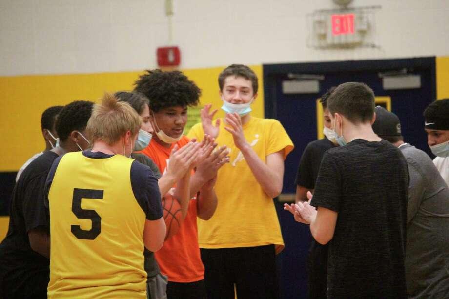 Baldwin basketball players meet after a recent practice. (Pioneer photo/John Raffel)