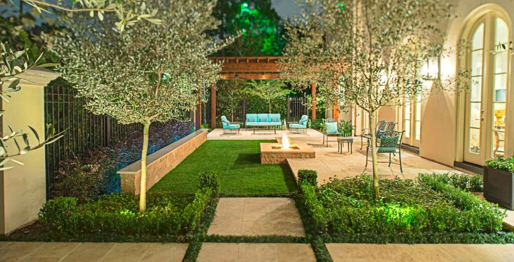 Plant-lined stone tiles are not for the faint of heart, that's why you may want to leave this one to the professionals or find your backyard-enthusiast friend. Houston company Heavenly Hardscape's mix of small trees, tightly organized stone work and a compact green space are a strong mix of function and play.