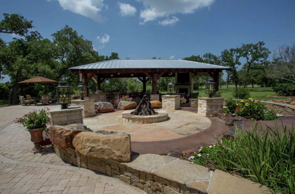 The backyard trifecta: a covered patio, fire pit and summer kitchen. Katy business Your Great Outdoors is aptly named for its ability to create livable nature settings that will please even the most discerning home guest. Best of all: with the exception of some gas for the grill, there's really no maintenance with this design. (The sprawling green expanse just beyond is another story.)