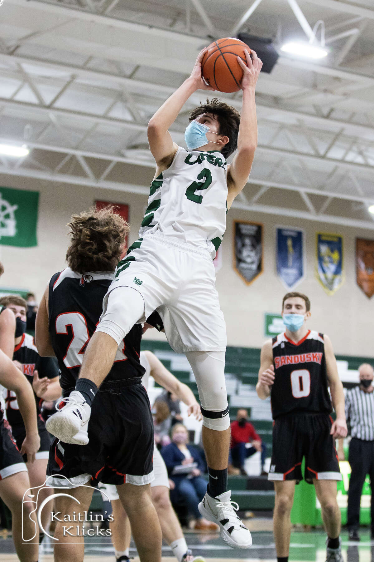 The Laker varsity boys basketball team opened the 2020-2021 season at home on Wednesday night with a 57-39 victory over the Sandusky Redskins.